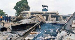 Burned vehicles are seen at the front gate of the Makala prison in Kinshasa