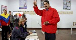 Venezuela's President Nicolas Maduro gestures after casting his vote at a polling station during a legislative election, in Caracas
